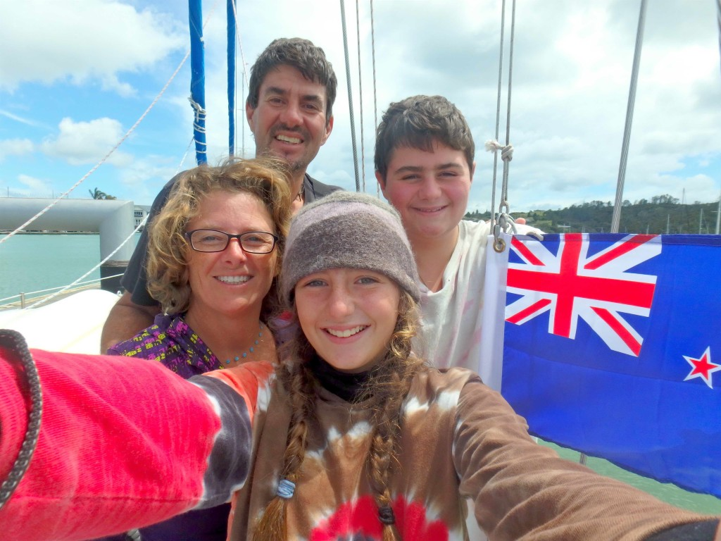 Checked In - Four very happy Batuligans hoist the New Zealand courtesy flag