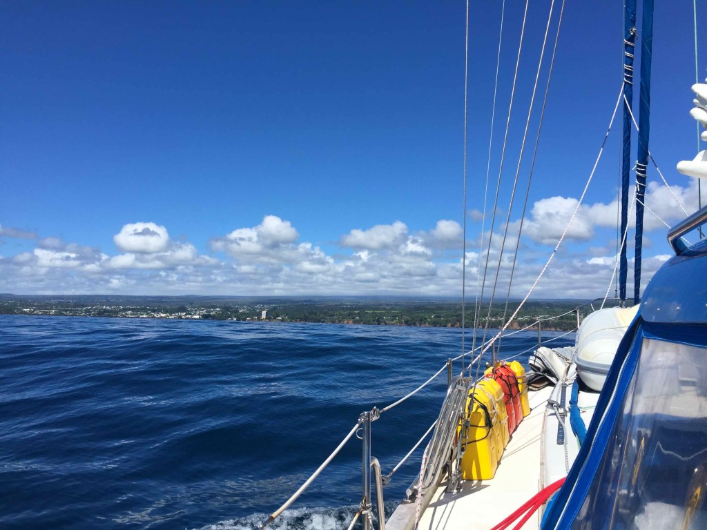 Approaching Hilo - Batu motors the last couple of miles as the wind backs off entering Hilo Bay